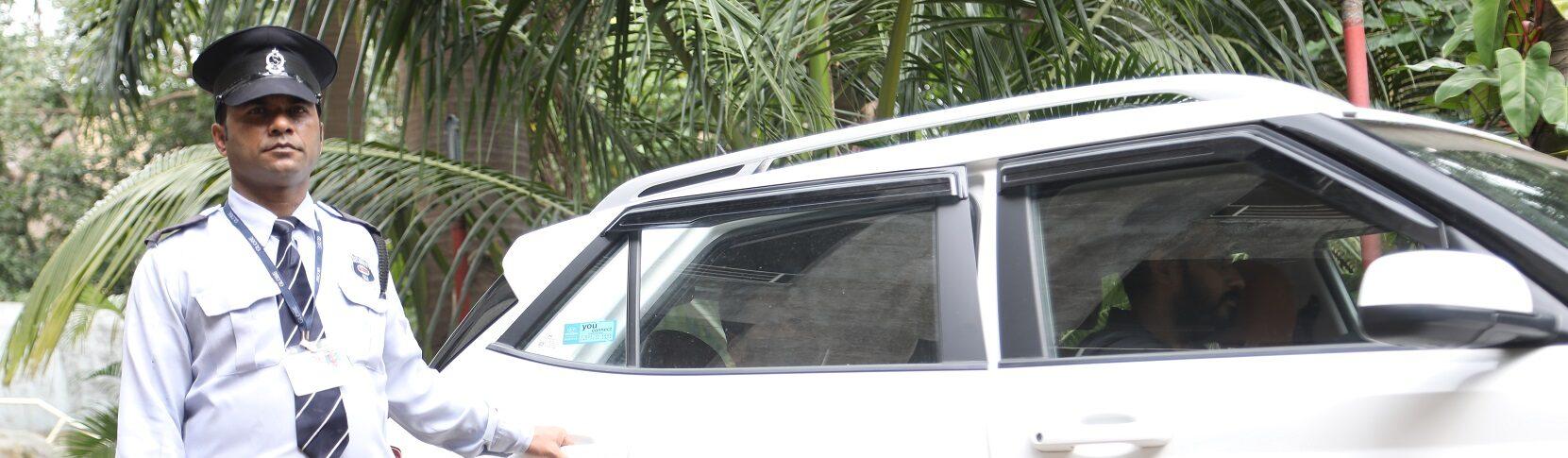Escort Guard opening the door of car for the employee