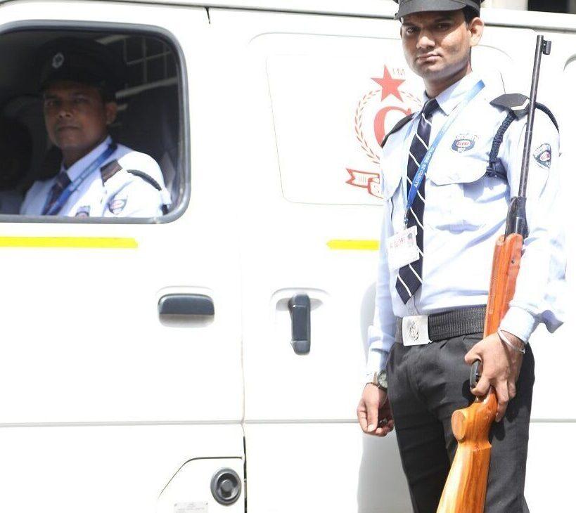 Armed Guard standing with Cash Van in Mumbai