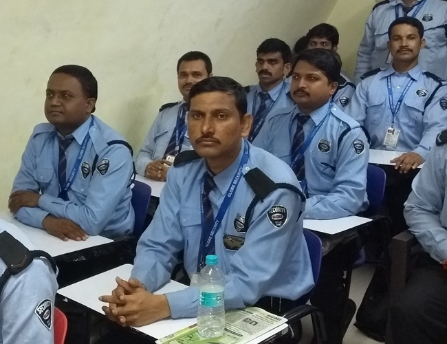 Security Guards sitting in Classroom Training