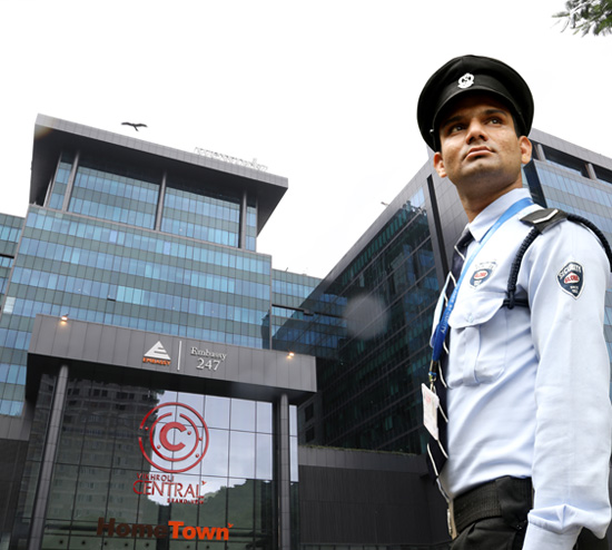 Security Guard for building in Mumbai standing outside commercial building