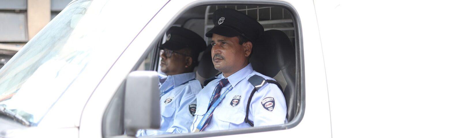 Escort Guards sitting inside vehicle in Mumbai