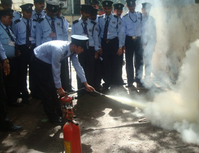 Security Guards Training to extinguish fire through fire extinguisher