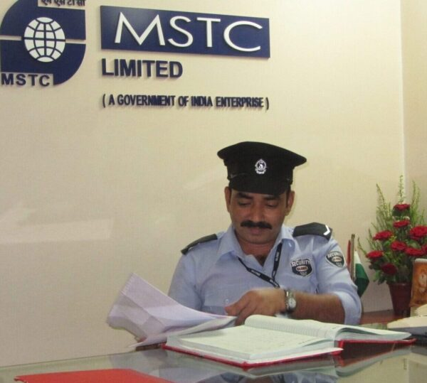 Security Guard at front desk in Mumbai making entries