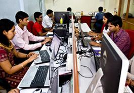 Temp Staff working on desktop in office