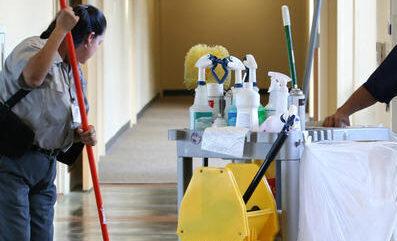 Housekeeping mopping the floor