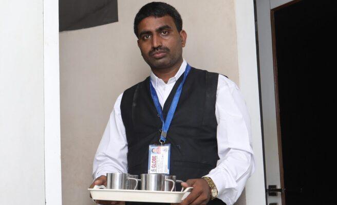 Pantry Boy in Mumbai Serving Tea